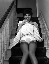 Excited beauty with nice body and in sexy retro lingerie poses right on the stairs this time
