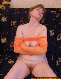 Orange pantyhose on MILF legs