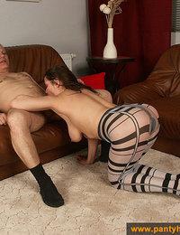 Pantyhose girl does a footjob in stripe pantyhose