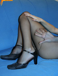 Black pantyhose ripped to show shaved pussy