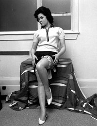 Gal in neat blouse and short skirt decides to show her vintage lingerie and long legs once again
