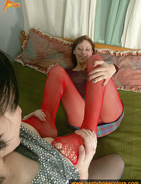 Pantyhose lesbians in red fishnet and black pantyhose