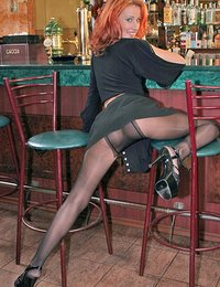 Stripping redhead in pantyhose